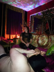 Queen Sensoria enjoying a good foot worship